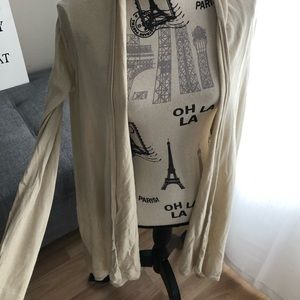 Creme coloured cardigan.